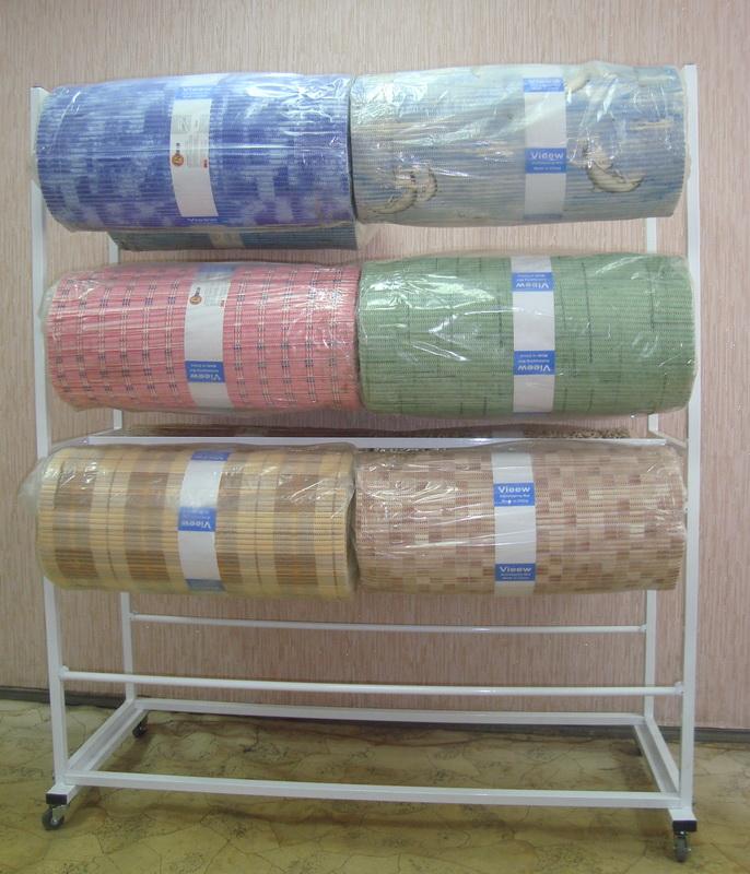 Стойка для рулонных ковриков. Торговое оборудование